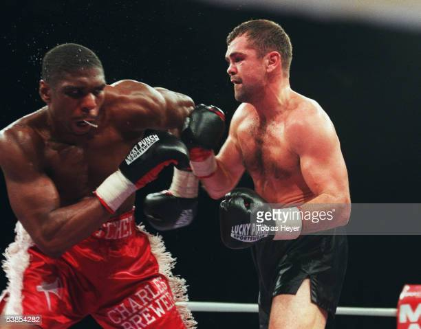 Sven Ottke of Germany try to punch Charles Brewer of USA during the super middleweight IBF World Championship fight on October 24, 1998 in...