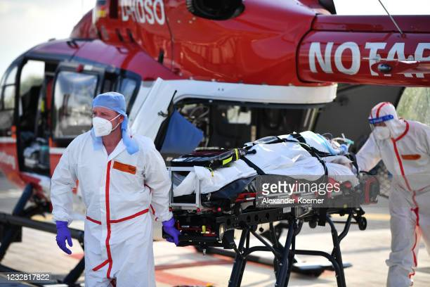 Sven Reckenbeil and Emergency doctor Martin Fleiderer, crew member of the DRF Luftrettung emergency air medical services arrive in an AIRBUS H145...
