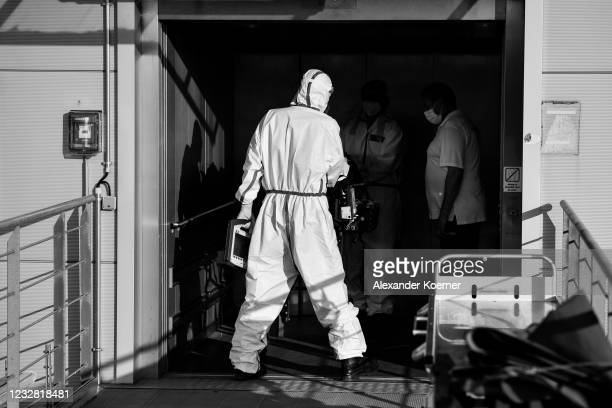 Sven Reckenbeil and Emergency doctor Martin Fleiderer, crew member of the DRF Luftrettung emergency air medical services arrive by an AIRBUS H145...
