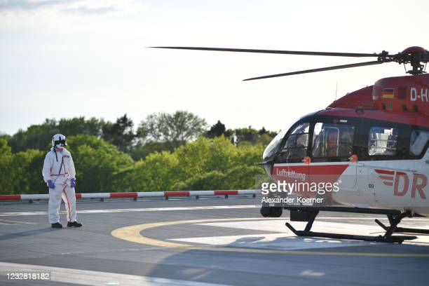 Sven Reckenbeil of the DRF Luftrettung emergency air medical services arrives in an AIRBUS H145 Helicopter with a Covid-19 patient at Charite...