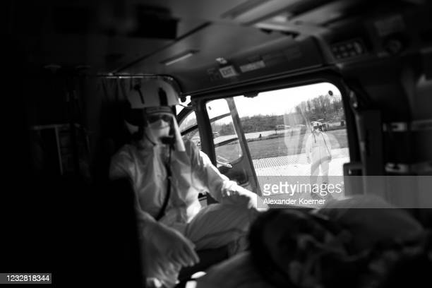 Sven Reckenbeil of the DRF Luftrettung emergency air medical services arrives by an AIRBUS H145 Helicopter with a Covid-19 patient at Charite...
