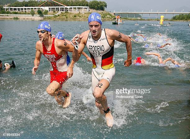 Sven Riederer of Switzerland and Jan Frodeno of Germany in action during the swimming section of the Men's Triathlon Final at the Triathlon Venue on...