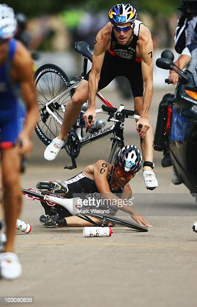 Sven Riederer of Switzerland crashes with Hirokatsu Tayama of Japan during the cycle leg of the Dextro Energy Triathlon Men's Race in Hyde Park on...