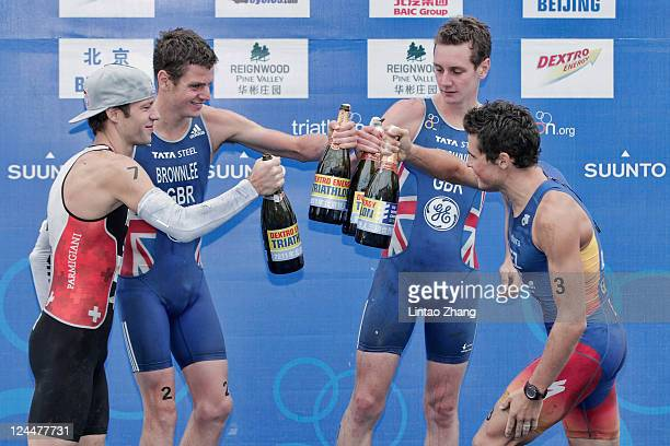 Sven Riederer of Switzerland Jonathan Brownlee of Great Britain Alistair Brownlee of Great Britain and Javier Gomez of Spain celebrate on the podium...