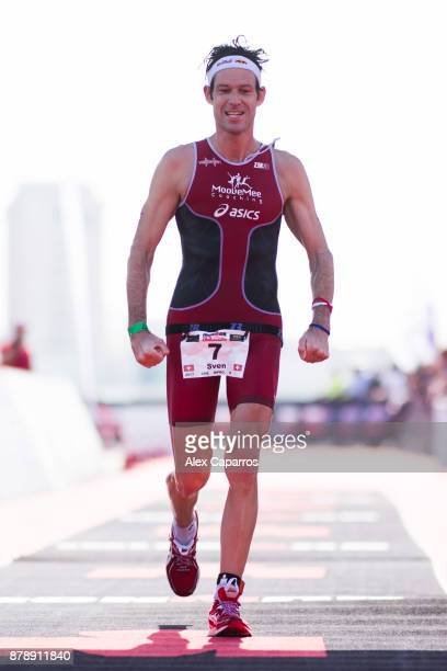 Sven Riederer of Switzerland reacts as he finishes in 3rd place the men's race of IRONMAN 703 Middle East Championship Bahrain on November 25 2017 in...