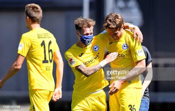 Sven Schipplock of Bielefeld celebrates with team mates during the Second Bundesliga match between Holstein Kiel and DSC Arminia Bielefeld at...