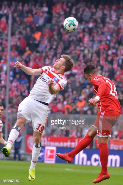 Sven Schipplock of Hamburg and Corentin Tolisso of Bayern Muenchen battle for the ball during the Bundesliga match between FC Bayern Muenchen and...