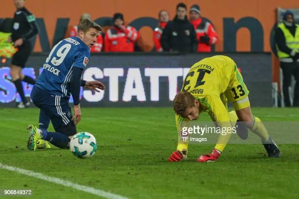 Sven Schipplock of Hamburg and Goalkeeper Julian Pollersbeck of Hamburg on the ground during the Bundesliga match between FC Augsburg and Hamburger...