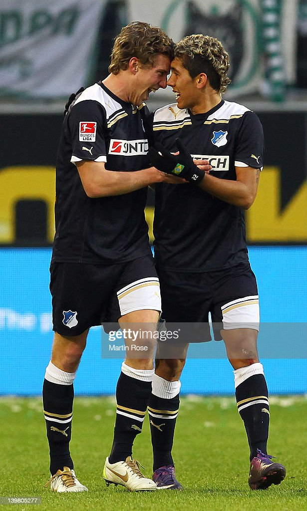 Sven Schipplock (L) of Hoffenheim celebrate with team mate Roberto Firmino (R) after he scores his team's 2nd goal during the Bundesliga match between VfL Wolfsburg and 1899 Hoffenheim at the Volkswagen Arena on February 25, 2012 in Wolfsburg, Germany.