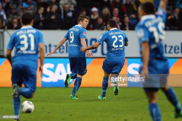 Sven Schipplock of Hoffenheim celebrates his team's first goal with team mates Kevin Volland Sejad Salihovic and Roberto Firmino during the...