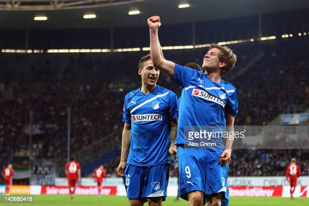 Sven Schipplock of Hoffenheim celebrates his team's fourth goal with team mates Sejad Salihovic and Fabian Johnson during the Bundesliga match...