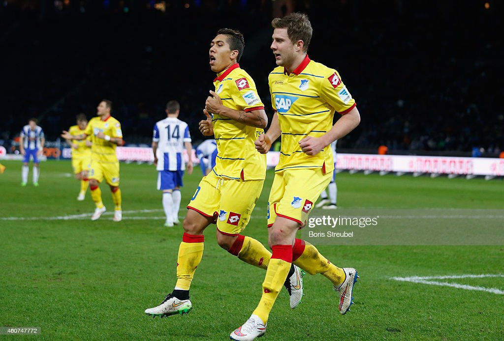 Sven Schipplock (R) of Hoffenheim celebrates with Roberto Firmino Barbosa de Oliveira after scoring his team's fourth goal during the Bundesliga match between Hertha BSC and 1899 Hoffenheim at Olympiastadion on December 21, 2014 in Berlin, Germany.