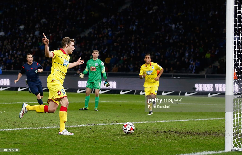 Sven Schipplock (L) of Hoffenheim scores his team's fourth goal during the Bundesliga match between Hertha BSC and 1899 Hoffenheim at Olympiastadion on December 21, 2014 in Berlin, Germany.