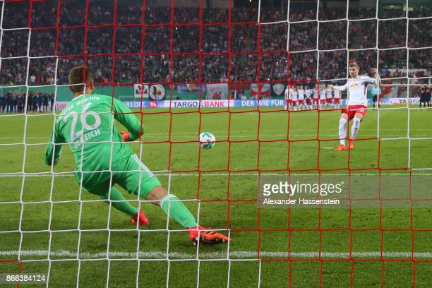 Sven Ulreich keeper of Bayern Muenchen saves a penalty by Timo Werner of Leipzig during the DFB Cup round 2 match between RB Leipzig and Bayern...