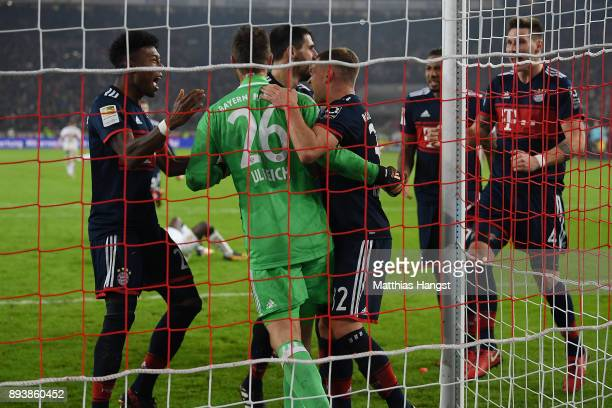 Sven Ulreich of Bayern Muenchen is congratulated by his team maes after he saved a penalty against Chadrac Akolo of Stuttgart during the Bundesliga...