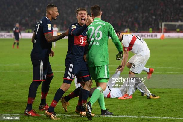 Sven Ulreich of Bayern Muenchen is congratulated by Thomas Mueller of Bayern Muenchen after he saved a penalty against Chadrac Akolo of Stuttgart...