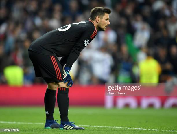 Sven Ulreich of Bayern Muenchen looks dejected as Karim Benzema of Real Madrid scores his sides second goal during the UEFA Champions League Semi...