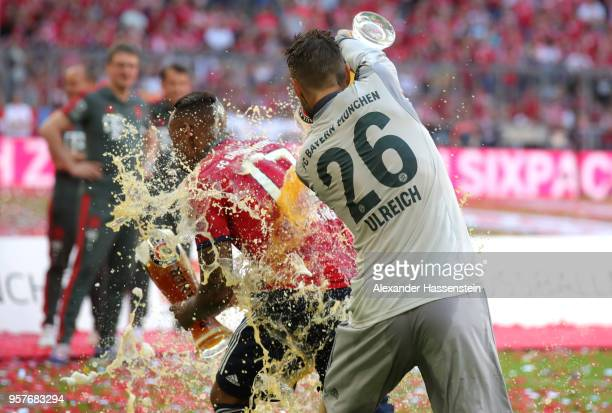 Sven Ulreich of Bayern Muenchen pours beer over Jerome Boateng of Bayern Muenchen after the Bundesliga match between FC Bayern Muenchen and VfB...