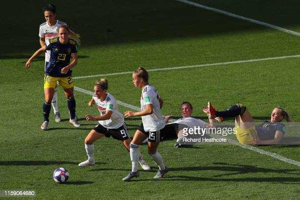 Svenja Huth and Giulia Gwinn of Germany clear the ball during the 2019 FIFA Women's World Cup France Quarter Final match between Germany and Sweden...