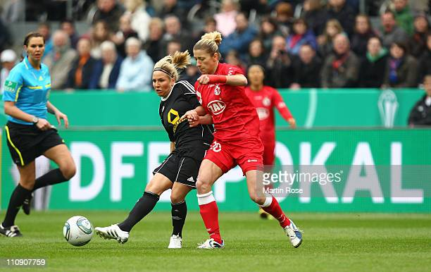 Svenja Huth of Frankfurt and Bianca Schmidt of Potsdam battle for the ball during the DFB Women's Cup final match between 1 FFC Frankfurt and Turbine...