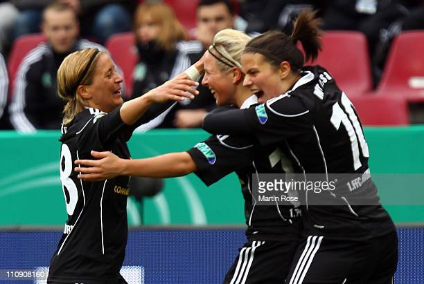 Svenja Huth of Frankfurt celebrates with her team mates after she scores her team's opening goal during the DFB Women's Cup final match between 1 FFC...