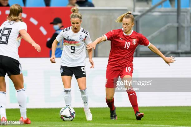 Svenja Huth of Germany and Zivana Stupar of Serbia battle for the ball during the FIFA Women's World Cup 2023 Qualifier group H match between Germany...