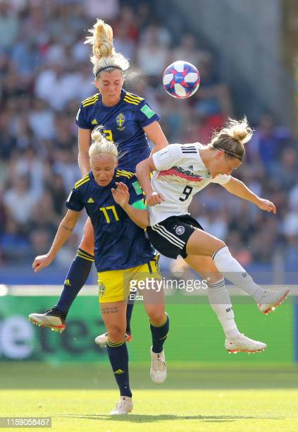 Svenja Huth of Germany battles for possession in the air with Caroline Seger and Linda Sembrant of Sweden during the 2019 FIFA Women's World Cup...
