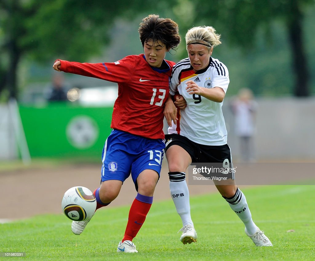 Svenja Huth (R) of Germany battles for the ball with Lee Eunkyung (L) of South Korea during the U20 international friendly match between Germany and South Korea at Waldstadion on June 2, 2010 in Giessen, Germany.