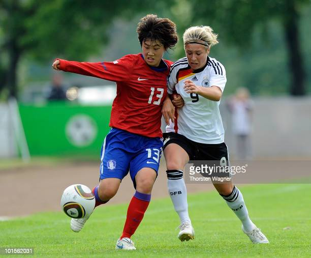 Svenja Huth of Germany battles for the ball with Lee Eunkyung of South Korea during the U20 international friendly match between Germany and South...