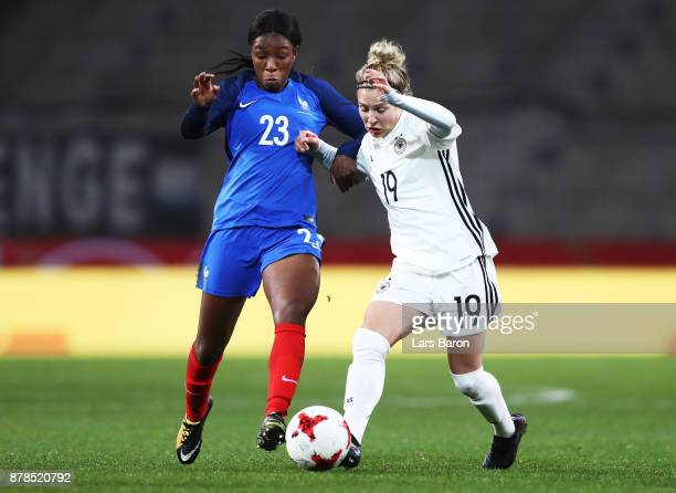 Svenja Huth of Germany challenges Grace Geyoro of France during the Germany v France Women's International Friendly match at Schueco Arena on...