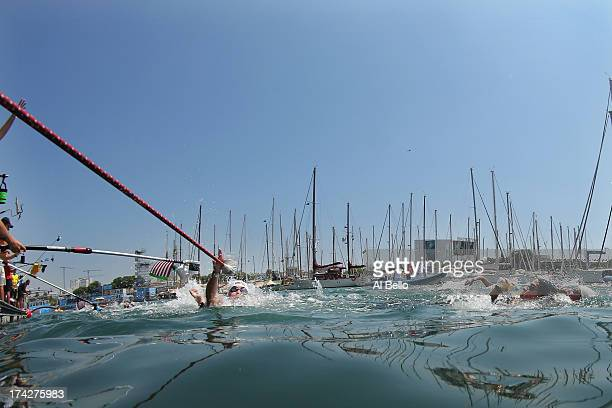 Svenja Theresa Zihsler of Germany grabs a drink during the Open Water Swimming Women's 10k race on day four of the 15th FINA World Championships at...