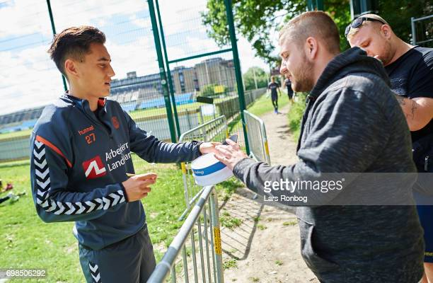 Svenn Crone of Brondby IF and fans of Brondby IF talking prior to the Brondby IF training session at Brondby Stadion on June 20 2017 in Brondby...