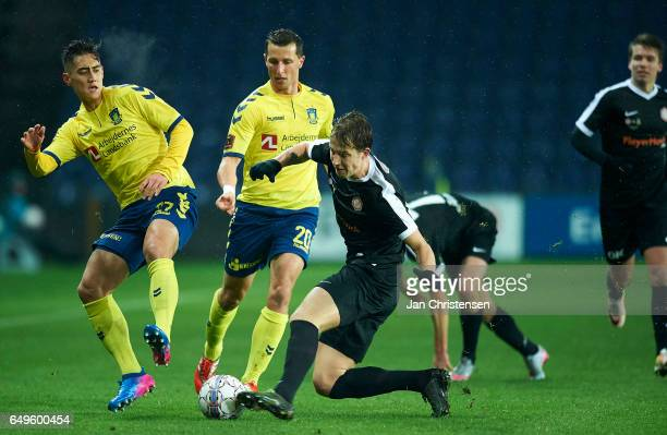 Svenn Crone of Brondby IF and Kamil Wilczek of Brondby IF compete for the ball during the Danish Cup DBU Pokalen match between BK Marienlyst and...