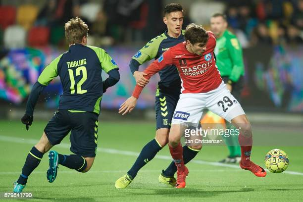 Svenn Crone of Brondby IF and Robert Skov of Silkeborg IF compete for the ball during the Danish Alka Superliga match between Silkeborg IF and...