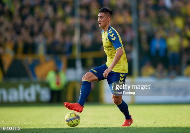 Svenn Crone of Brondby IF controls the ball during the Danish Alka Superliga match between OB Odense and Brondby IF at EWII Park on September 10 2017...
