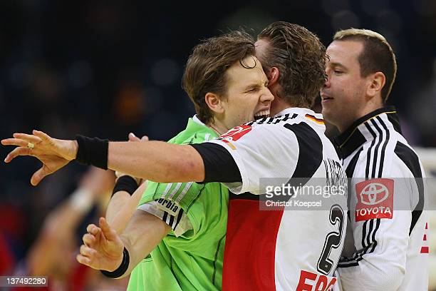 Sven-Soeren Christophersen of Germany celebrates the decision goal to play a 21-21 draw with Lars Kaufmann and Pascal Hens during the Men's European...