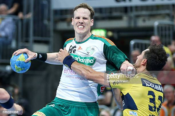 SvenSoeren Christophersen of Hannover is challenged by Alexander Petersson of RheinNeckar Loewen during the DKB Handball Bundesliga match between...