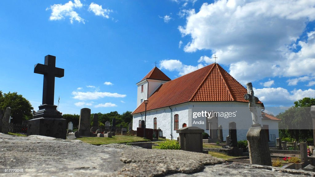 Sverige. . Cemetery surrounding a chapel with white walls and cross on Styrso Island, main island of the southern archipelago of Gothenburg, in the south-west of the country.