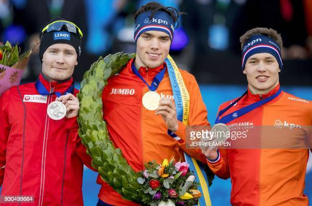 Sverre Lunde Pedersen from Norway winner Patrick Roest from The Netherlands and Marcel Bosker from The Netherlands pose on the podium with their...