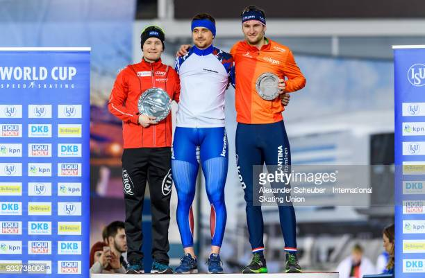 Sverre Lunde Pedersen of Norway Denis Yuskov of Russia and Thomas Krol of the Netherlands stand on the podium after the Overall Classification in the...