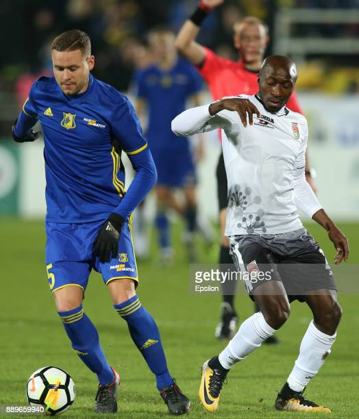 Sverrir Ingi Ingason of FC Rostov RostovonDon vies for the ball with Kehinde Fatai of FC Ufa during the Russian Premier League match between FC...