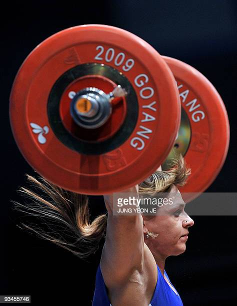 Svetiana Podobedova of Kazakhstan attempts a lift in the snatch of the women's 75kg category event at the World Weightlifting Championships in Goyang...