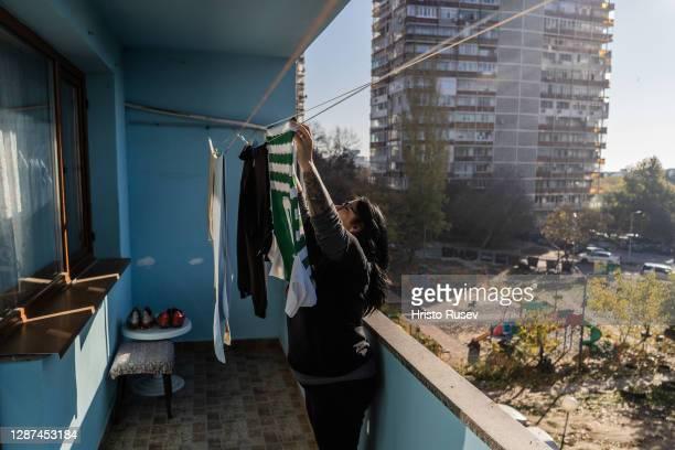 Svetla Georgieva hanging the laundry to dry on the balcony in her home on November 24, 2020 in Varna, Bulgaria. Svetla Georgieva, 47 years-old,...