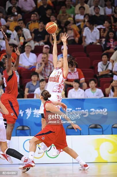 Svetlana Abrosimova of Russia shoots against the U.S. Women's Senior National Team during the women's semifinals basketball game at the 2008 Beijing...