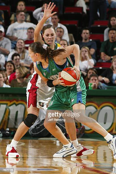 Svetlana Abrosimova of the Minnesota Lynx is defended by Adia Barnes of the Seattle Storm during the game at Key Arena in Seattle Washington on June...