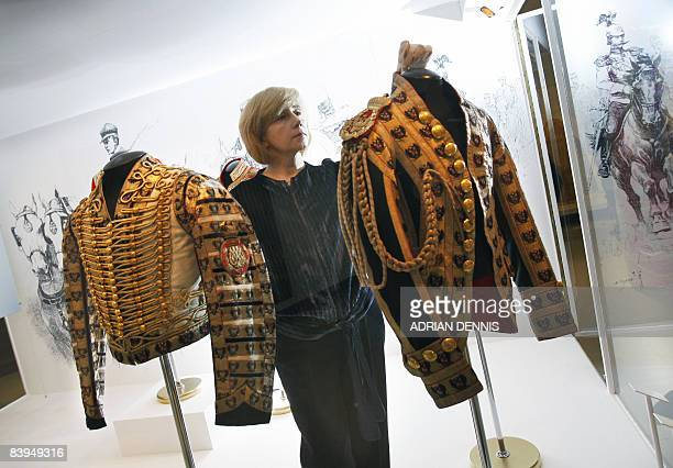 Svetlana Amelekhina a Curator at the Moscow Kremlin Museum adjusts a coachmans' jacket while preparing an exhibition at The Victoria and Albert...