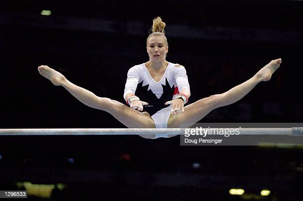 Svetlana Boguinskaya of Belarus does mid-air splits while competing in the uneven bars, part of the Womens Team Gymnastics competition at the 1996...