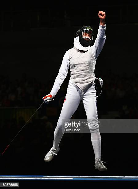 Svetlana Boyko of Russia celebrates victory against Emily Cross of the United States in the Women's Team Foil Gold Medal Match at the Fencing Hall on...