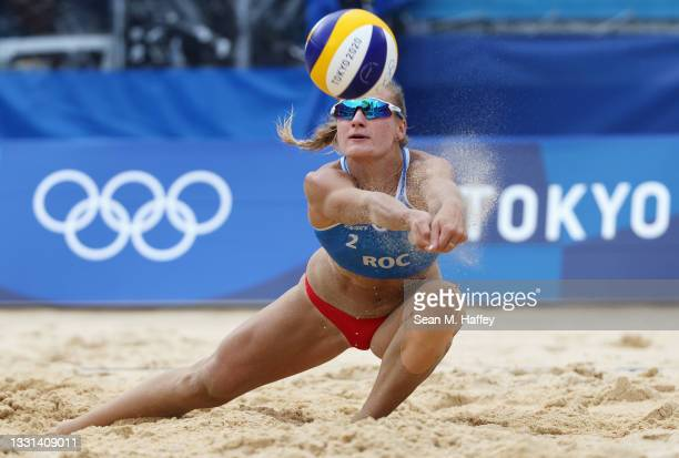 Svetlana Kholomina of Team ROC competes against Team Australia during the Women's Preliminary - Pool E beach volleyball on day seven of the Tokyo...