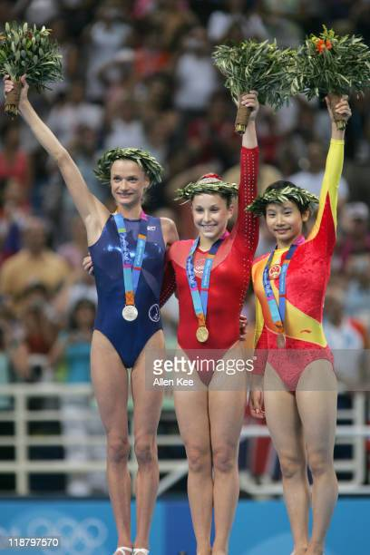 Svetlana Khorkina of Russia Carly Patterson of the United and Nan Zhang of China in the Women's Individual AllAround in Olympic Indoor Hall at the...